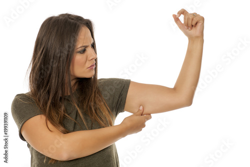 Valokuva  beautiful woman pinching fat on her hand on white background