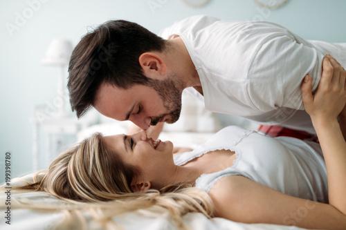 Papiers peints Statue Portrait of young loving couple in bedroom