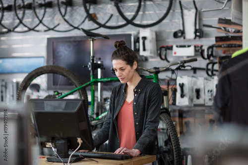 Small business owner using computer in a store