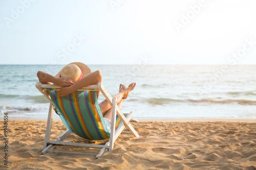 Spoed Foto op Canvas Ontspanning Woman on beach in summer