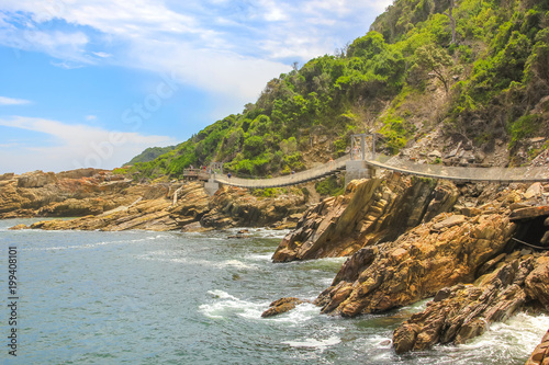Foto op Plexiglas Zuid Afrika Suspended Bridges during trekking route over Storms River Mouth in Tsitsikamma National Park, Eastern Cape, near Plettenberg Bay in South Africa. Famous tourist destination along Garden Route.