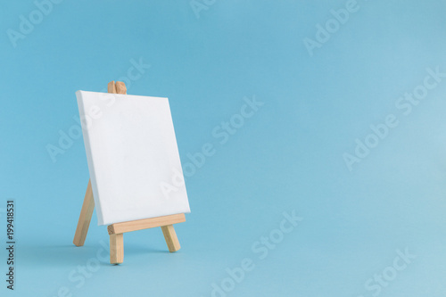 Empty canvas on easel Wallpaper Mural