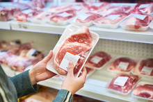 Buyer Hands With Pork Meat At ...