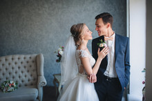 Beautiful Newlyweds Stand In A...