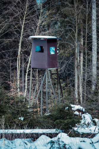 Fotobehang Jacht Deer hunting post in winter forest. Winterberg, Germany.