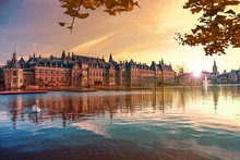 Sunset On The Binnenhof Building And The Hague City Reflected On The Pond With A Swan Swimming On, Netherlands