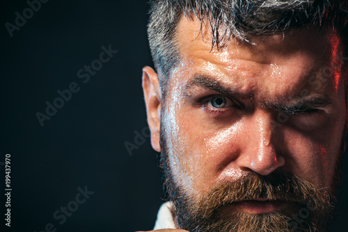 Portrait of boxer before fight, closeup. Partial view of a karate man in kimono. Portrait of handsome aikido fighter. Copy space.