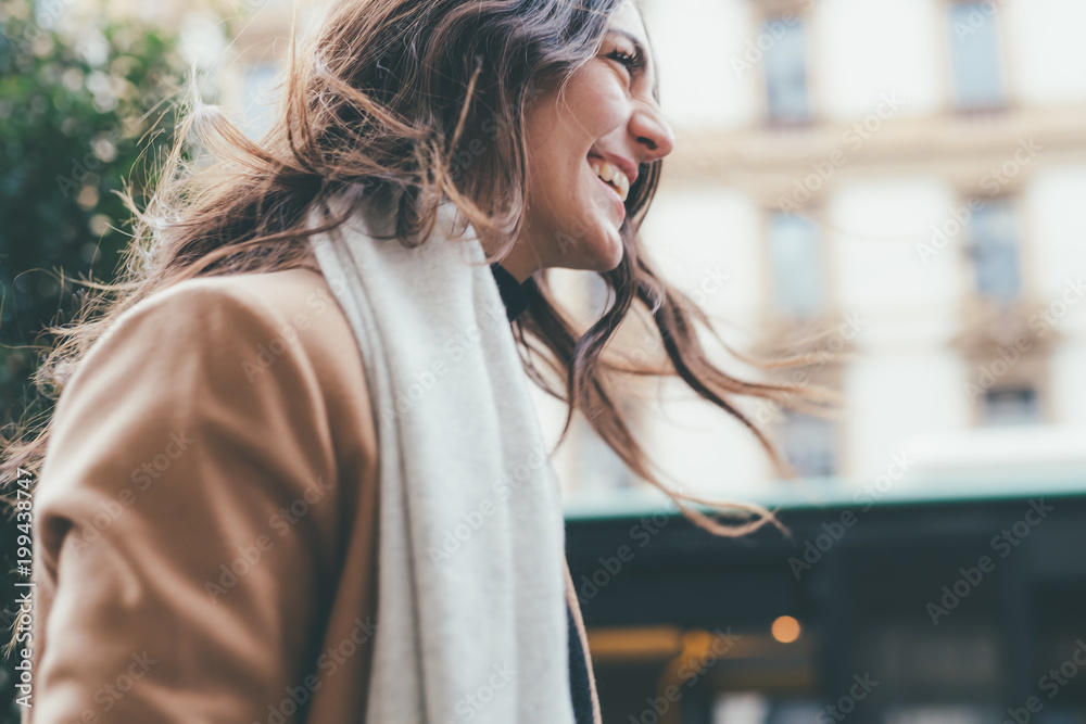 Fototapeta young woman walking outdoors smiling - happiness, positive emotions, getting away from it all concept