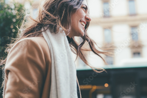 Fotografiet  young woman walking outdoors smiling - happiness, positive emotions, getting awa