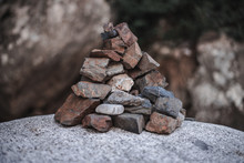 Pile Of Small Stones On Rock