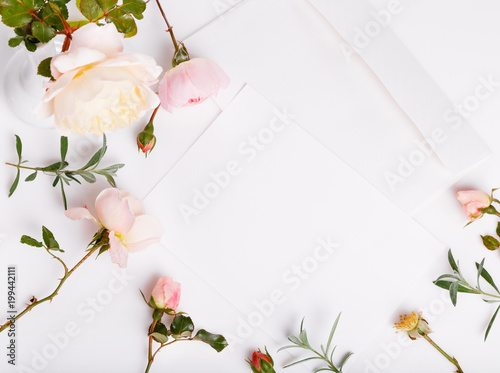 Letter White Envelope On White Background With Pink English Rose