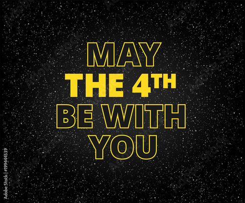 Photo  May the 4th be with you holiday background - yellow letters on starry sky backgr