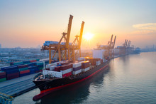 Aerial View Of Business Port With Shore Crane Loading Container In Container Ship In Import/export And Business Logistics With Crane And Shipping Cargo.International Transportation Concept.