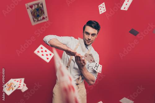 Cuadros en Lienzo Professional, cunning joyful magician, illusionist, gambler with tricky glance i