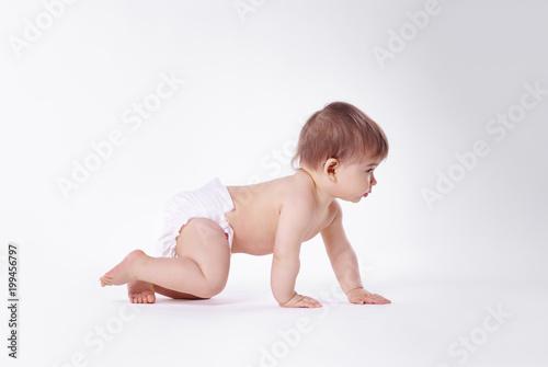 Fotografiet Baby crawling at studio shot