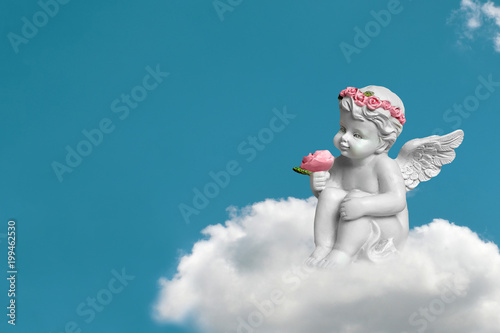 Leinwand Poster Cherub sitting on the cloud