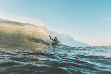 Young Man Boogie Boarding A Clean Bright Wave. Extreme Water Sports And Outdoor Active Lifestyle. Vintage Filter With Soft Style