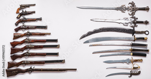 Photo Antique military weapons, swords, knives, guns and pistols