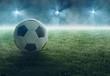canvas print picture Fußball liegt im Flutlicht