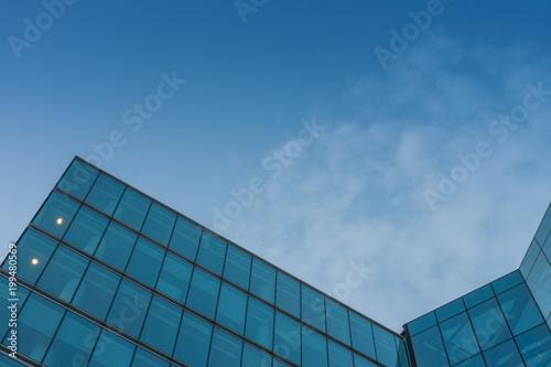 Fototapeta Glass facade, modern architecture with blue sky, morning shoot obraz na płótnie