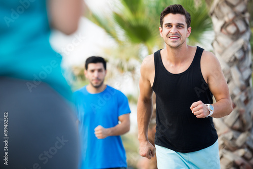 Fotografia, Obraz  Portrait of adult man who is jogging with friend