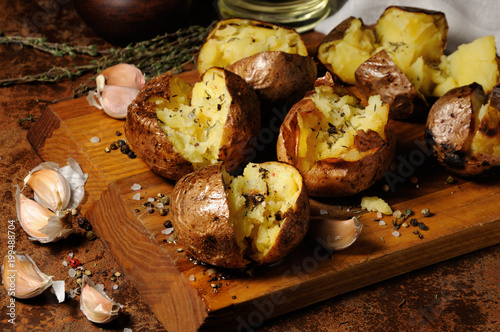 Fototapeta baked potato with spices and herbs obraz