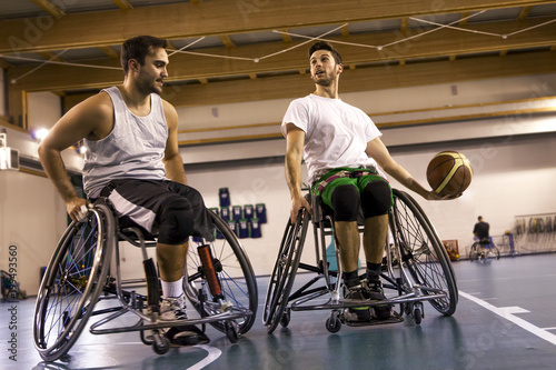 disabled sport men in action while playing basketball