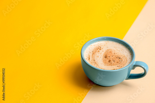 Cup of aromatic hot coffee on color background