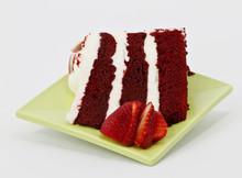 Spring Green Plate Holds Three Layer Red Velvet Cake Slice