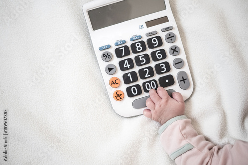Baby hand and calculator with text space background
