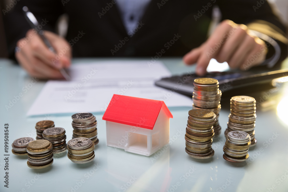Fototapety, obrazy: Close-up Of House Model And Stacked Coins On Desk