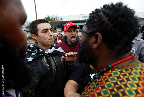 Supporters of U S  President Donald Trump argue with people