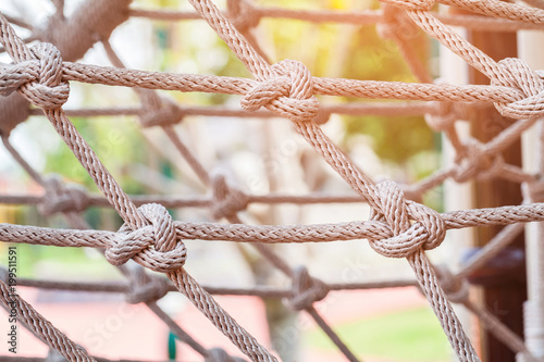 Valokuva  Close-up of rope knot line tied together with playground background