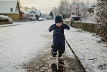 Baby Boy Walking On Street In ...
