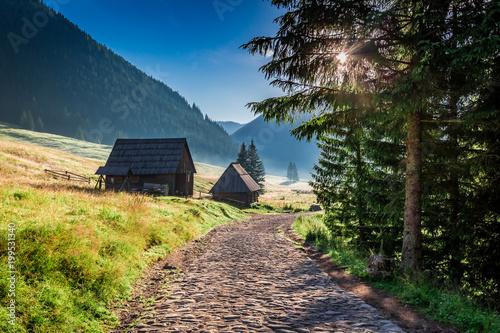 Foto auf Gartenposter Gebirge Stunning valley with cottages in Tatra Mountains at sunrise, Poland