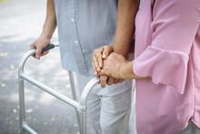 Assisting Her Senior Patient W...