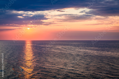 Foto op Plexiglas Zee zonsondergang Dynamic dusk over calm ocean in summer, Baltic sea