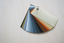 Fan Of Colorful Adhesive Vinyls On A Wooden Background.