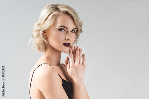 blonde young woman posing in elegant black dress, isolated on grey Tablou Canvas