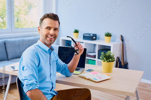 Poster  Handsome man working from home office