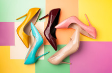 Set Of Colored Women's Shoes On A Colored Background