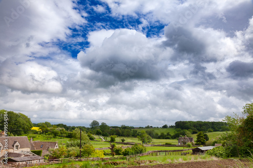 Foto op Aluminium Bleke violet English rural landscape with dramatic sky over small village Southern England UK