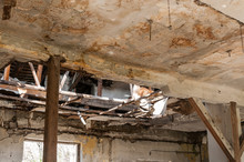 Damaged House. Collapsed Roof Of The Total Damaged Domestic House Indoor From Natural Disaster Or Catastrophe