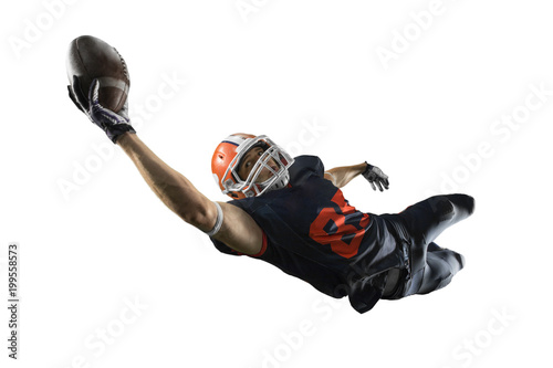 Fotografiet  Isolated American football player catches the ball and fly in white background