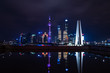 Shanghai Skyscrapers and reflections on the river at night