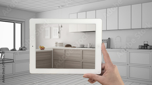 Hand holding tablet showing real finished minimalist white and ...