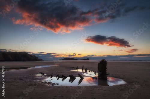 Fotografie, Tablou  Sunset at Worms Head and the wreck of the Helvetia, at Rhossili Bay on the Gower