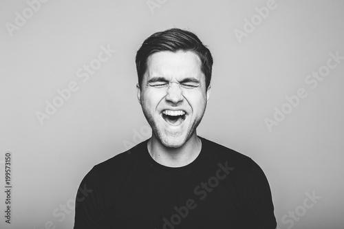 Fototapety, obrazy: Anger, rage, shout  man  standing  on  grey background.