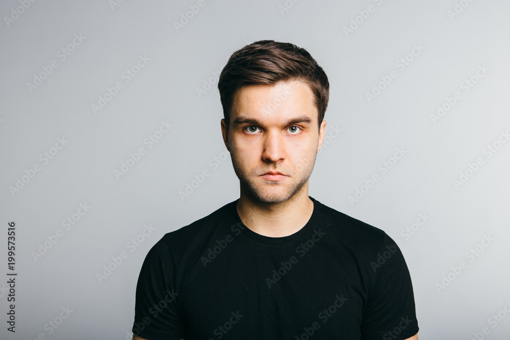 Fototapeta Serious man portret on grey background.