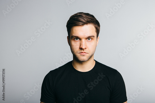 Obraz Serious man portret on grey background. - fototapety do salonu